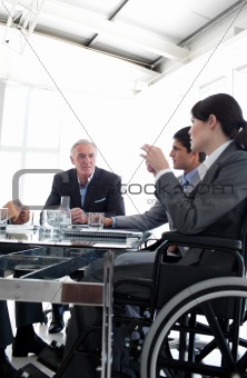 Businesswoman in a wheelchair during a meeting