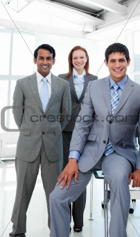 Business people in a line smiling at the camera