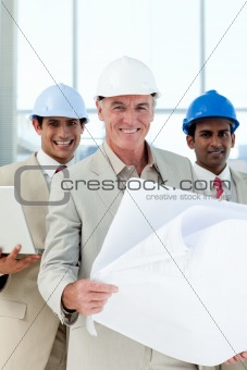 Attractive architect holding blueprints