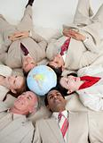 International business people lying on the floor around a terres