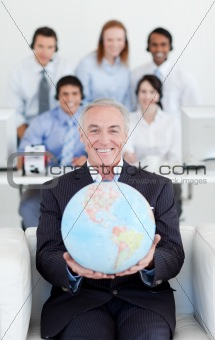 Smiling businessman holding a terrestrial globe