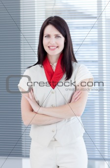 Portrait of an attractive businesswoman with folded arms