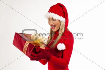 Atrtractive Santa girl with present