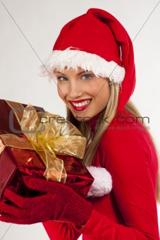 Attractive Santa girl with present