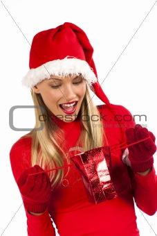 Attractive Santa girl surprising while receiving a Christmas pre