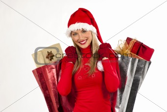 Attractive Santa girl with presents bags
