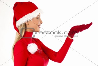 Beautiful Santa girl on white presenting/holding something