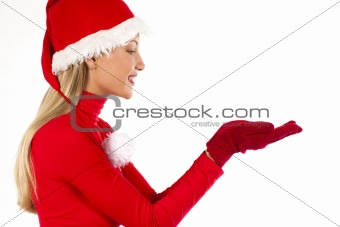 Beautiful Santa girl on white presenting/holding something with