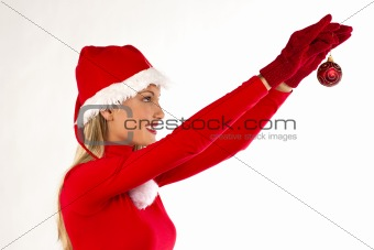 Beautiful Santa girl on white holding a Christmas ball