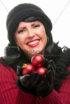 Attractive Woman Holding Red Ornaments Isolated on a White Background.