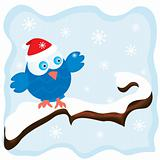 Winter image with cartoon blue bird wearing a red christmas hat