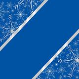 Dark blue winter frame with silver snowflakes an space for your