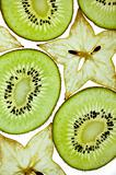 Sliced Kiwifruit and Starfruit isolated on white