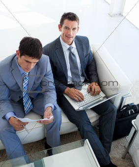 Businessmen relaxing before a job interview in a waiting room