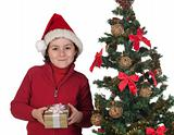Beautiful child with Christmas trees and gift