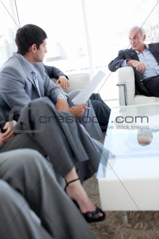Business people discussing in a waiting room