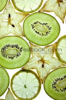 Sliced Kiwifruit, Lemon and Starfruit isolated on white