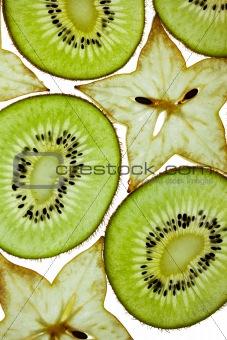 Sliced Kiwifruit and Starfruit isolated on white