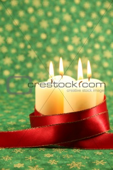 Candles with ribbon on Christmas background