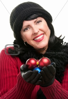 Attractive Woman Holding Christmas Ornaments Isolated on a White Background.