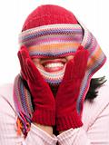 Attractive Woman With Colorful Scarf Over Eyes Isolated on a Whiite Background.