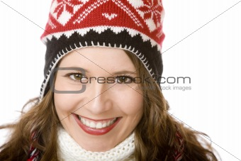 Portrait of young attractive smiling woman with cap and scarf in