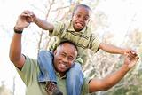 African American Man and Child Having Fun in the Park.