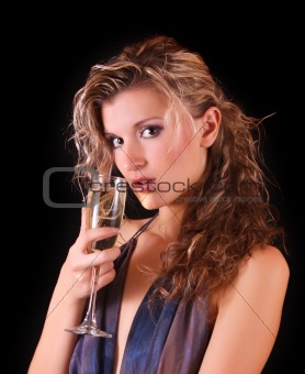 Beautiful woman with a glass of champagne on black background