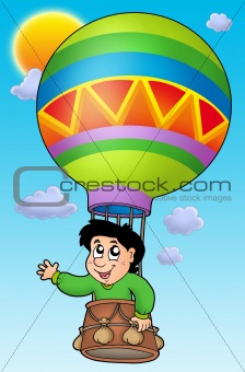 Boy in balloon on sky