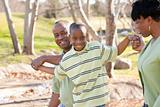 Happy African American Man, Woman and Child Having Fun in the Park.