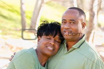 Attractive Happy African American Couple Posing in the Park.