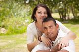 Attractive Hispanic Couple Portrait in the Park.