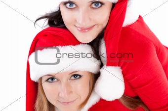 Two girl friends in christmass costumes.