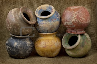 six clay plant pots with grunge finish