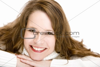 Portrait of young attractive woman with chin on hands smiling ha