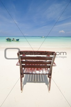 a beach with a lonely chair