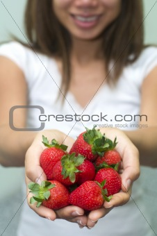 asian girl holding strawberry