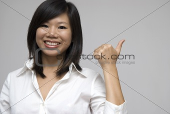 asian women smiling and giving thumbs up