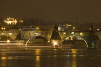prague, charles bridge - boat traffic on vltava river at night