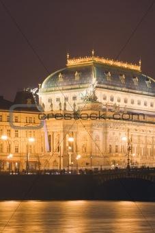 prague - illuminated national theater and legii bridge at night