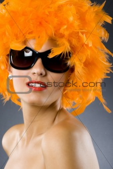 young pretty woman wearing an orange feather wig