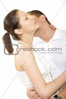 Man kisses young woman