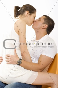 young man kiss girl on chair