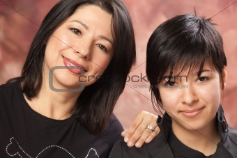 Attractive Multiethnic Mother and Daughter Studio Portrait.