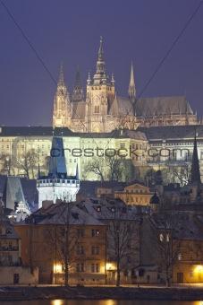 prague in winter - lesser town (mala strana) and hradcany castle at dusk
