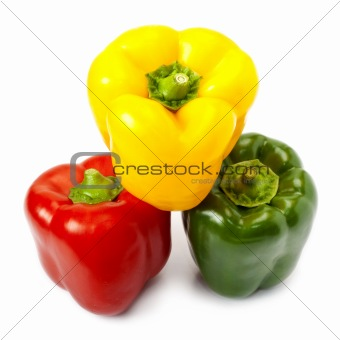 Three sweet peppers in yellow, red and green