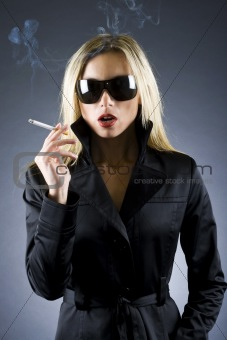 blond woman holding a cigarette