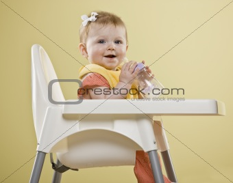 Baby Girl in High Chair