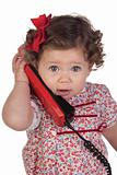 Funny baby girl with red telephone