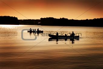 Silhouette of Canoers on Lake